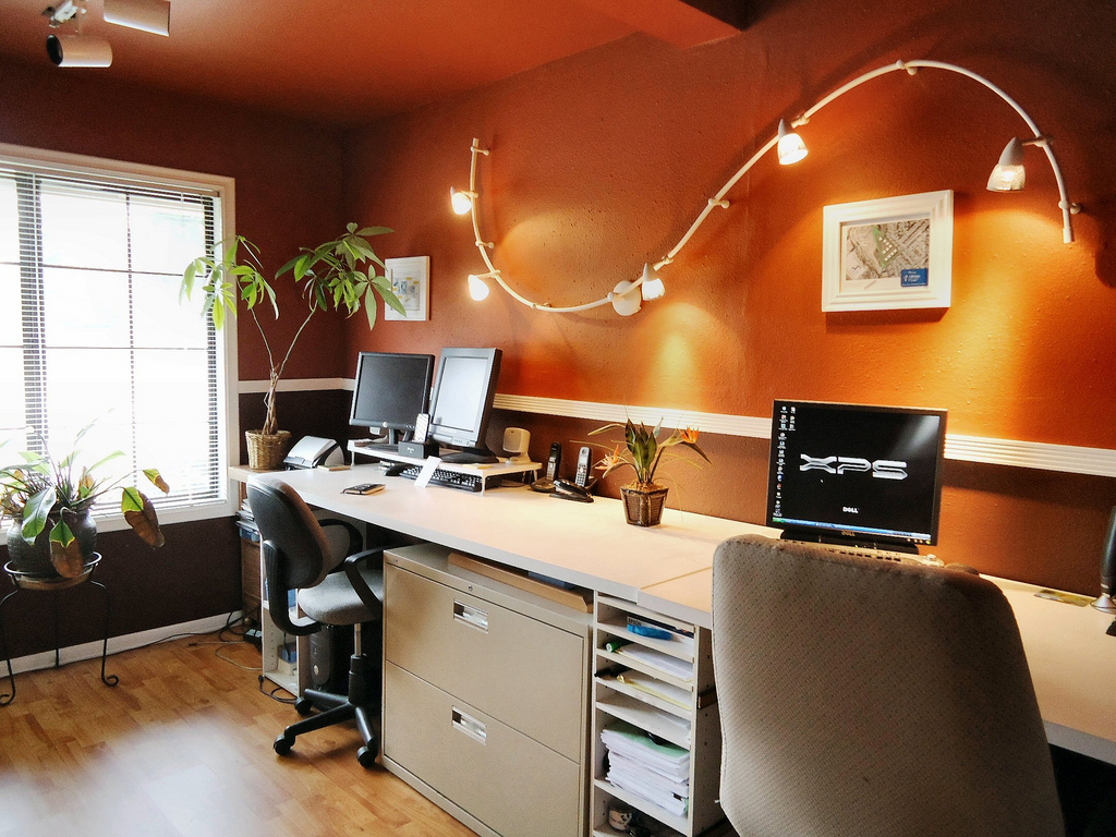 Modern Home Office Design With Dark Orange Wall